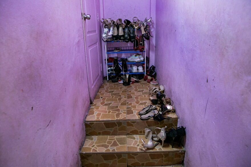 Shoes line the stairway by the living quarters for sex workers at a bar in Pattaya.