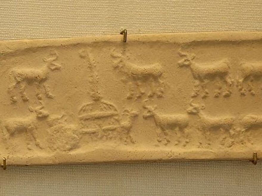 Cylinder seal and impression showing a cattle herd at the cowshed from Mesopotamia in the  Uruk Period (4100 BC–3000 BC).