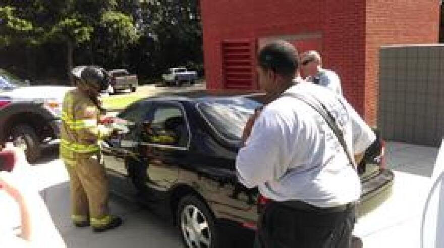 A Tallahassee emergency crew demonstrates the techniques used to rescue an infant left alone in a vehicle sweltering in the summer sun.