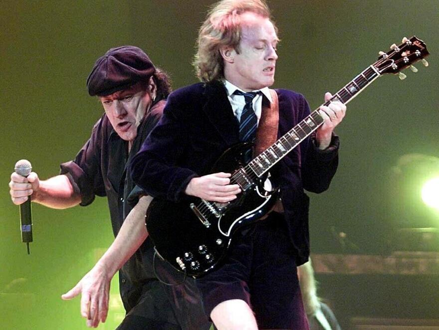 Brian Johnson (L) and Angus Young of AC/DC in 2000. Johnson's first album with the group, 1980's <em>Back In Black</em>, is one of the best-selling albums of all time, despite never reaching No. 1 on the <em>Billboard </em>album chart.