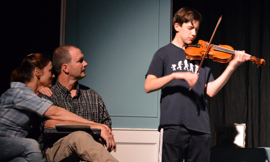 Kara Campbell, Kirsten Wylder, and husband James, Scott De Broux, look on at son Thomas, Robin Stricklin as he learns to feel the music.