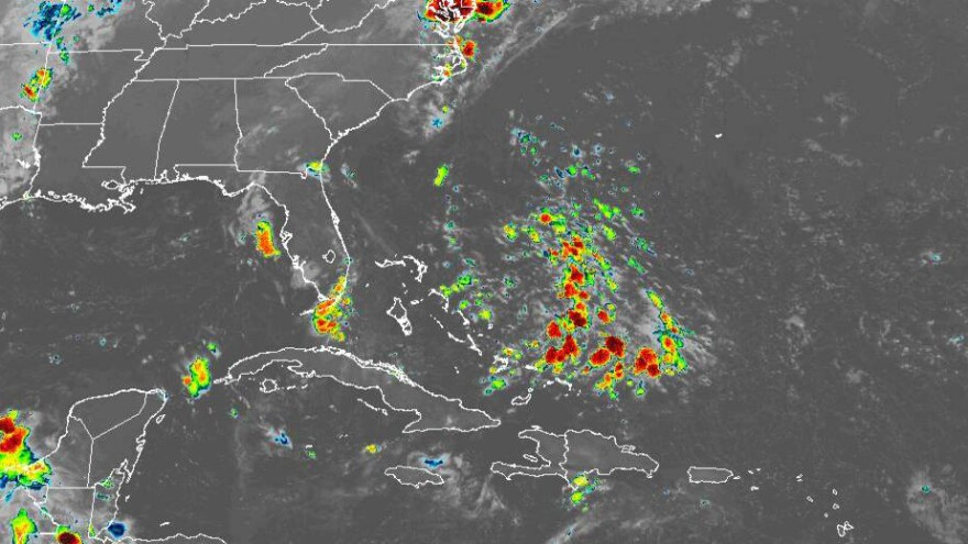 A satellite image shows an area of disturbed weather east of the Bahamas that will drift toward Florida this weekend.