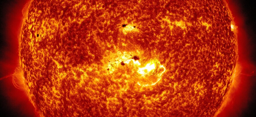 <strong>Coming At You:</strong> An image created by NASA combines two pictures from its Solar Dynamics Observatory. One shows the location of a large sunspot; the other shows Tuesday's massive solar flare.