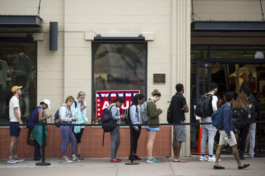 Voters line up outside of The University Co-op across the street from UT Austin on Nov. 8, 2016.