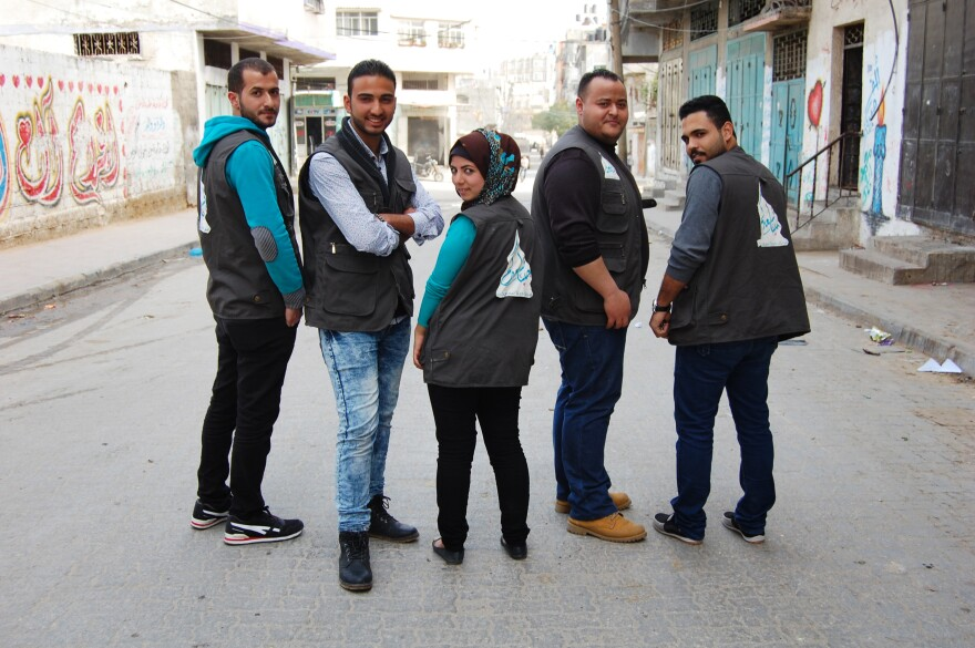 "Activist Ramzy Herzalla (second from right) recruited friends to join the We Are Here to Make You Happy team and help needy Gazans. The charity, he says, ""is a message to the government that it is supposed to be helping the people this way."""