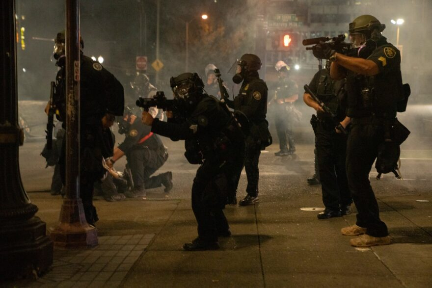 Police use tear gas and impact munitions to disperse protesters in downtown Portland, Ore., during 4th of July demonstrations against systemic racism and police violence.