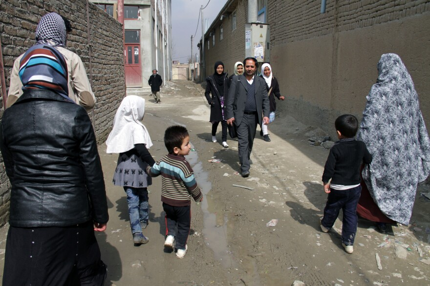 Aziz Royesh (center) in the streets near the Marefat School in Kabul.