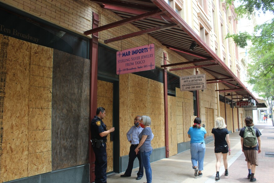 Windows on Houston Street are boarded up following Saturday's protests.