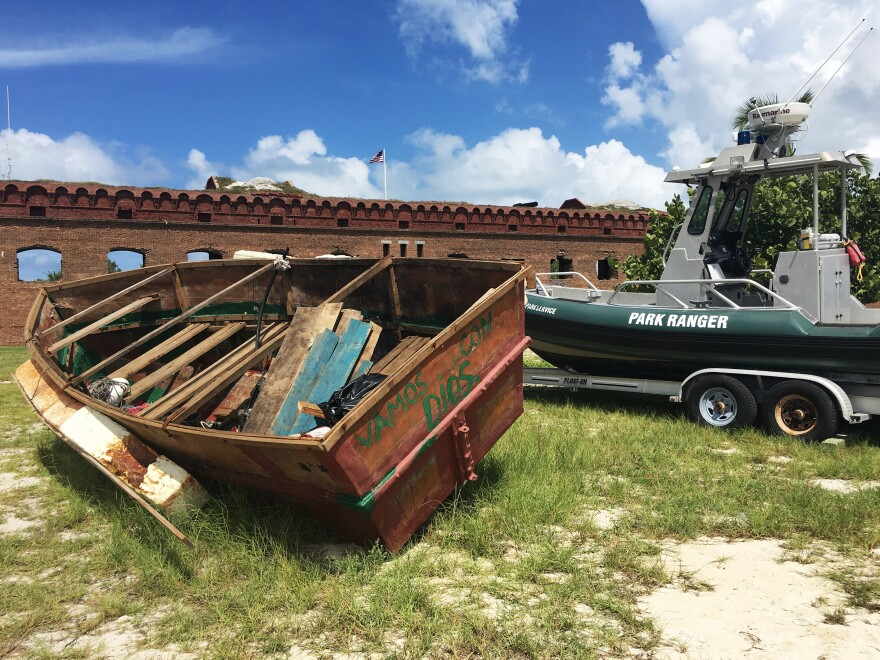 """A Cuban migrant vessel (left) known as a """"chug"""" landed recently at Dry Tortugas National Park in Florida, 70 miles from Key West in the Gulf of Mexico. The vessels are homemade and often have engine trouble."""