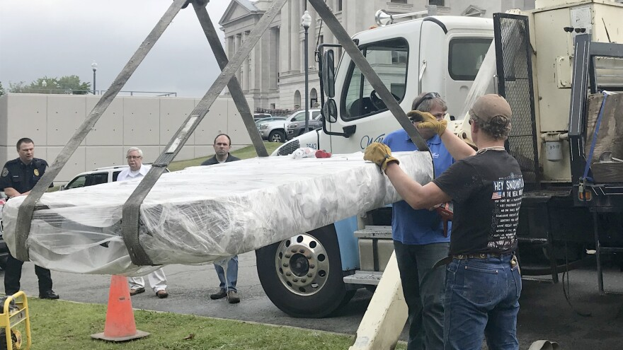 Workers used a crane to install a Ten Commandments monument Thursday outside the Arkansas state Capitol in Little Rock.