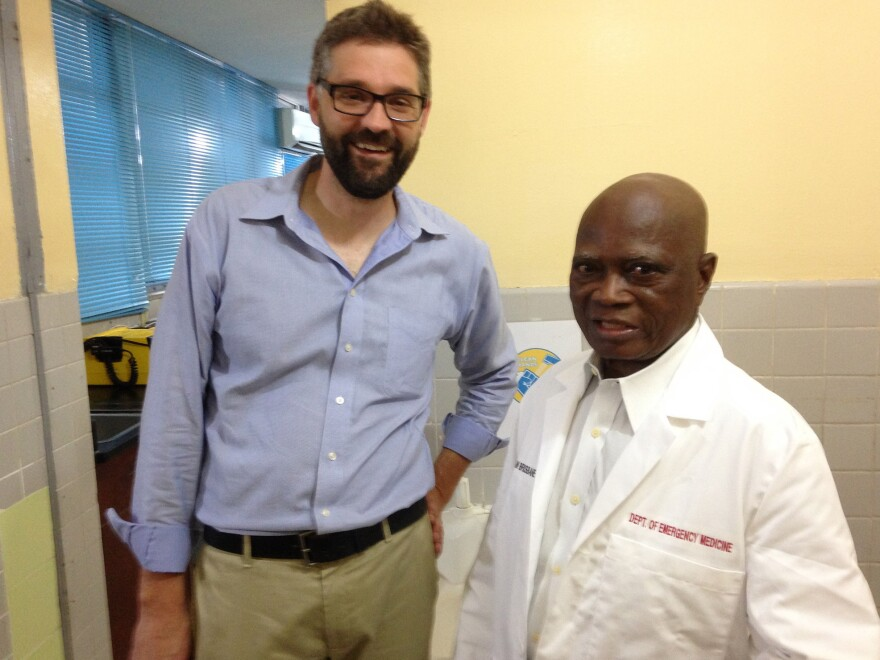 Emergency room doctor Joshua Mugele (left) stands with Dr. Samuel Brisbane at Liberia's JFK Hospital, which saw its first Ebola patient in June.