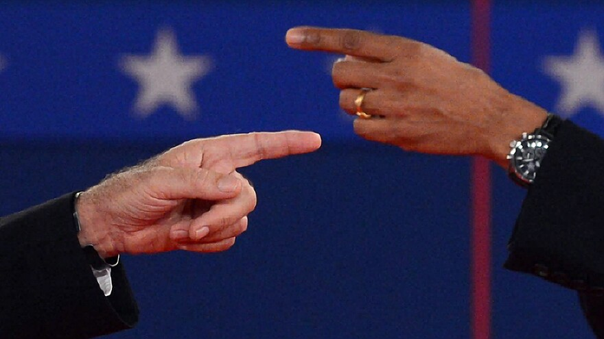 The fingers tell the story: At times, President Obama and Republican challenger Mitt Romney got very close Tuesday night during their exchanges.