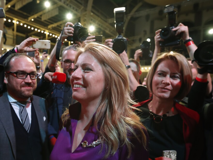 Zuzana Caputova, elected as Slovakia's first female president, greets supporters on Saturday evening.