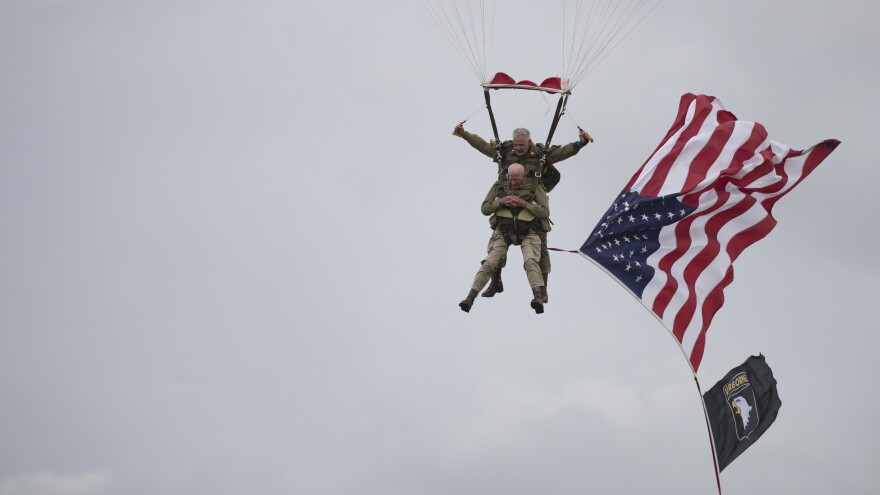 U.S. World War II D-Day veteran Tom Rice, from Coronado, Calif., parachutes in a tandem jump into a field in Carentan, Normandy, France, on Wednesday. Approximately 200 parachutists participated in the event, replicating a jump made by U.S. soldiers on June 6, 1944 — D-Day.