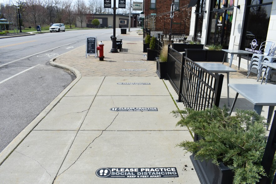 social distancing measures outside of Butcher and Sprout in Cuyahoga Falls