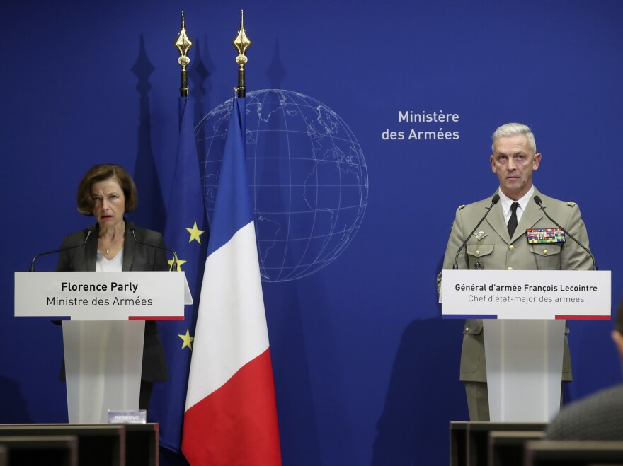 French Defense Minister Florence Parly (left) and French Army Chief of Staff Gen. François Lecointre said Tuesday that two helicopters collided in midair and killed 13 French soldiers fighting Islamic extremists in Mali.