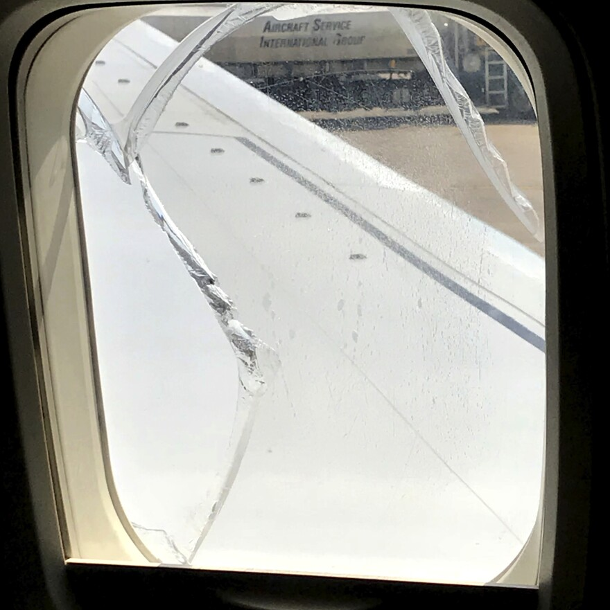 A crack is seen on a window of Southwest Airlines Flight 957 after an abrupt landing in Cleveland on Wednesday.