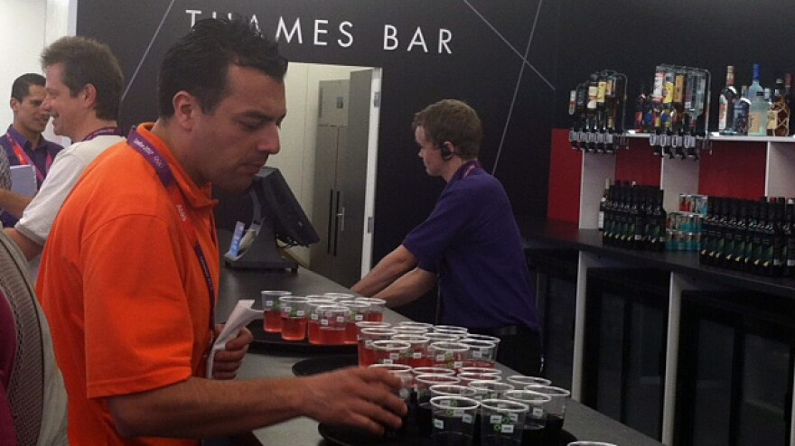 "The ""Thames Bar"" was flowing with free drinks Monday, as the London 2012 group welcomed journalists to the Main Press Center."