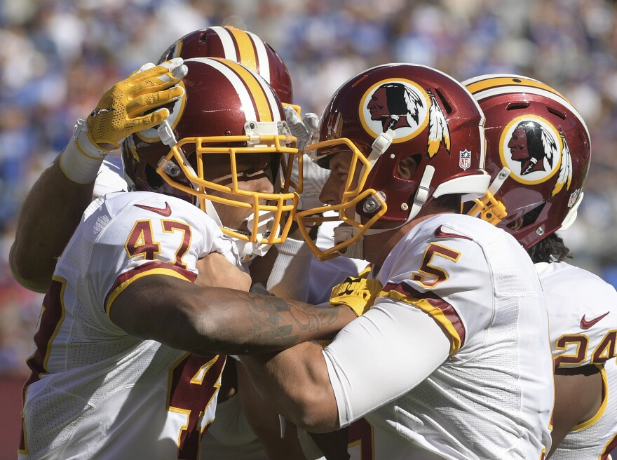 Washington Redskins players celebrate during a game against the New York Giants at MetLife Stadium on Sunday.