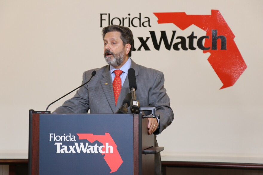 Florida TaxWatch CEO Dominc Calabro speaks at a press conference.