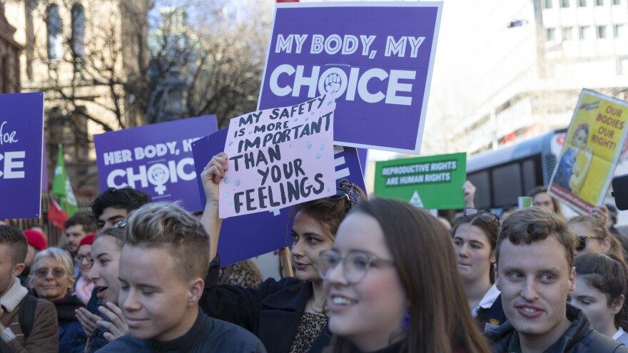 Residents of Sydney attend a rally last month at Parliament House in support of decriminalizing abortion.