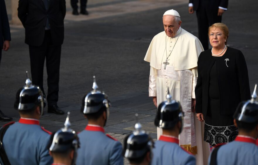 Pope Francis is welcomed by Chile's President Michelle Bachelet at La Moneda Presidential Palace in Santiago on Tuesday. The pope landed in Santiago late Monday on his first visit to Chile since becoming pope, and his sixth to Latin America — a trip that will also take him to Peru.