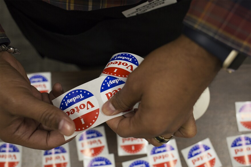 """A poll worker sets out """"I voted today"""" stickers at the St. Louis County Board Of Elections on Oct. 25, 2018."""