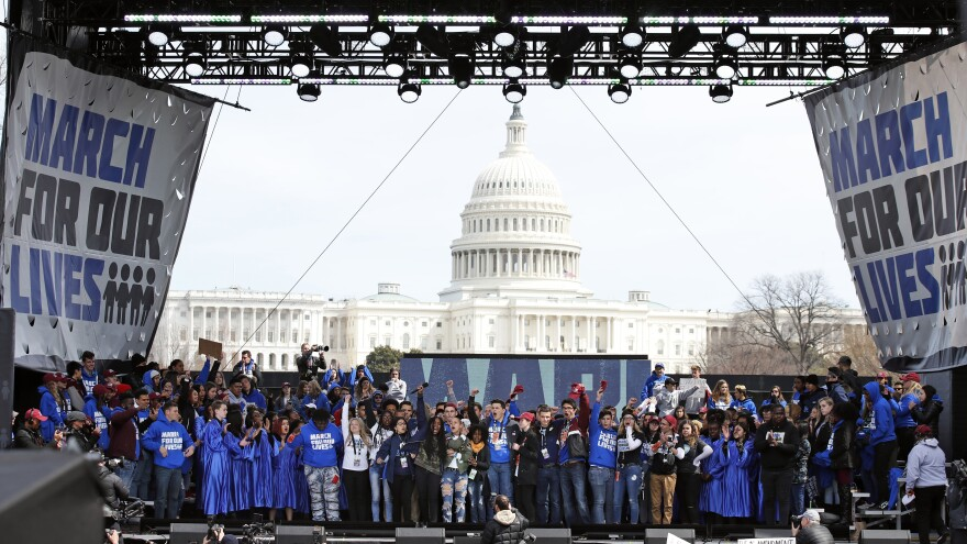 """Supporters fill the stage at the end of the """"March for Our Lives"""" rally in support of gun control, on March 24, 2018, in Washington."""