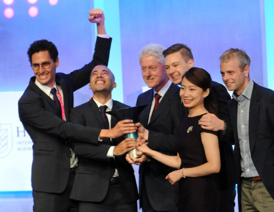 The winning IMPCT team poses with former President Bill Clinton and (at far right) Philip Hult, co-chairman, EF Education First. The team members (from left) are Andres Escobar, Juan Diego Prudot, Taylor Scobbie and An-Nung Chen