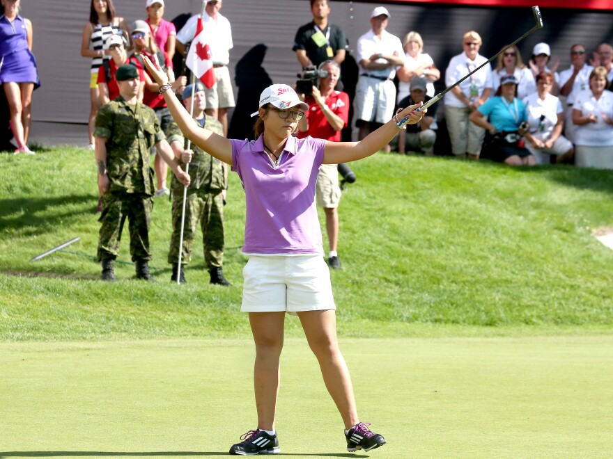 Lydia Ko of New Zealand reacts as she birdies the final hole to win her second consecutive Canadian Women's Open Sunday. Because Ko is an amateur, she didn't receive the winner's check for $300,000.