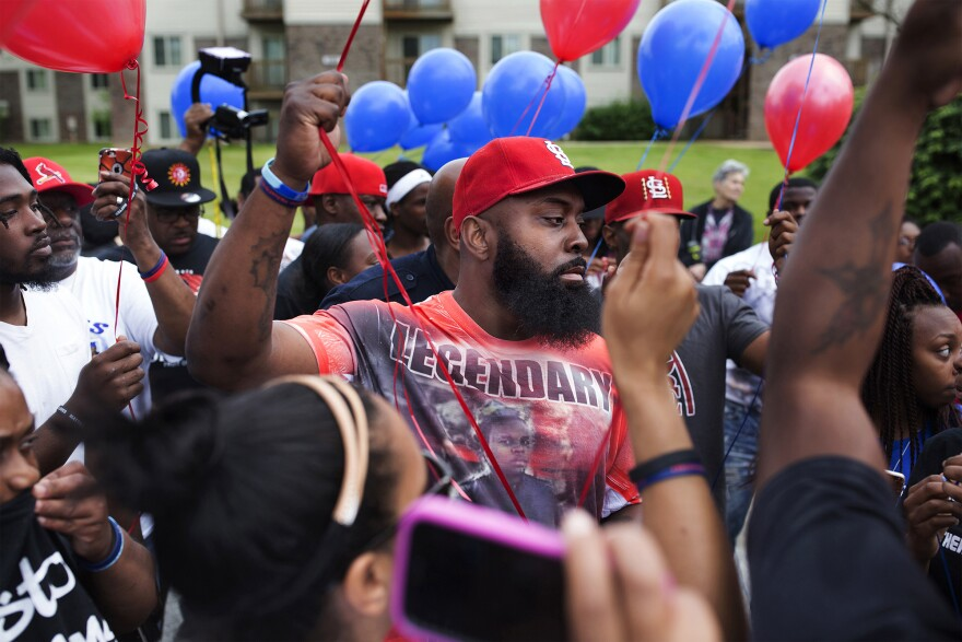 Michael Brown Sr. gets ready to release balloons to honor what would have been his son's 20th birthday at a party to honor Mike Brown's life at Canfield Green Apartments in Ferguson, Mo., on May 20, 2016.