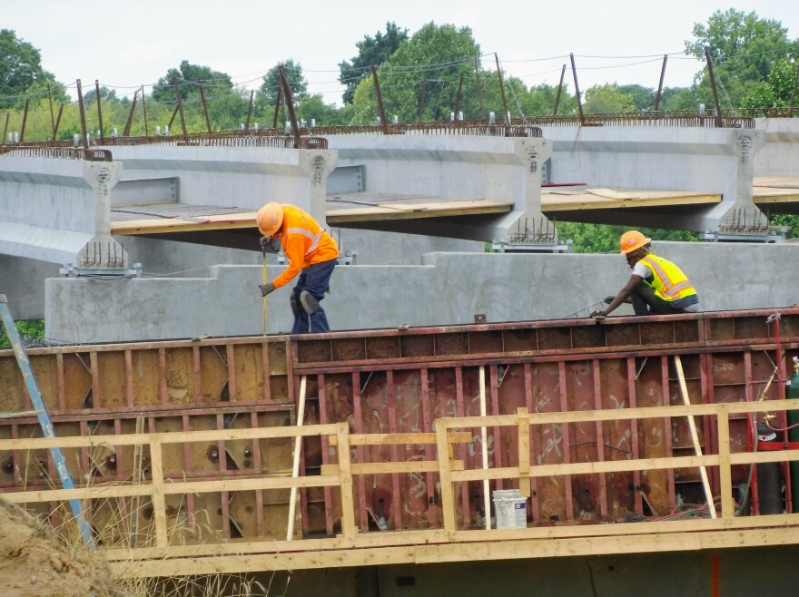Workers construct a ramp from I-277 to I-77 southbound near uptown Charlotte Monday.