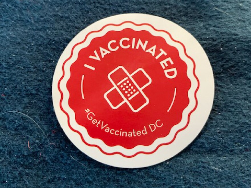 No lollipops at the vaccination center, but they were giving out stickers.
