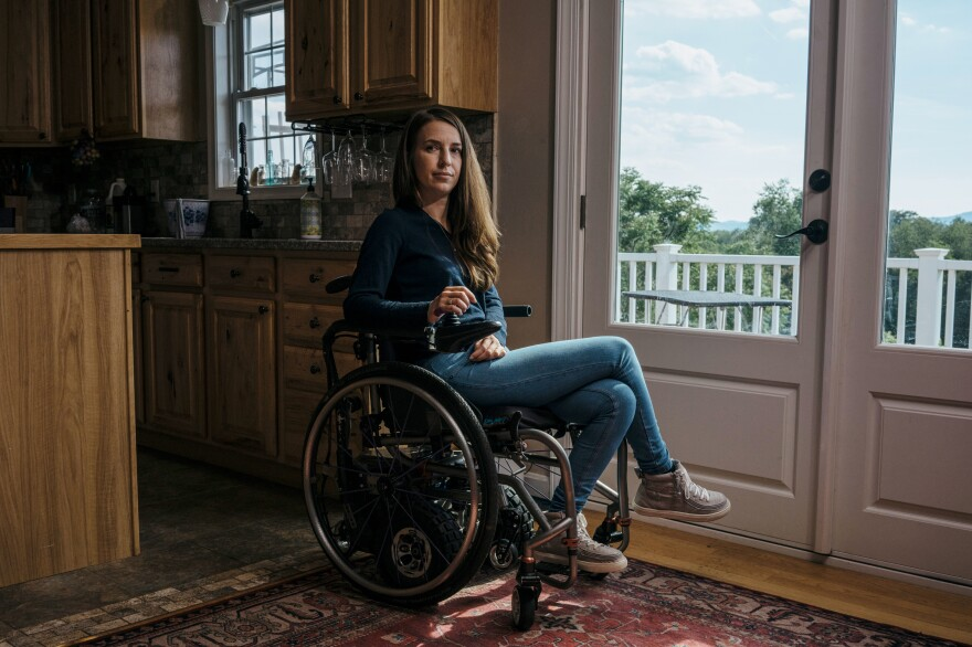 Dani Izzie at her home in rural Virginia. More than a decade ago, she slipped in the bathroom and suffered a spinal cord injury that has left her unable to walk. She works as a social media manager for Spinergy, a company that makes high-performance wheels for wheelchairs.