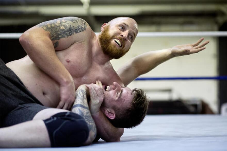 Leland Race wrestles Sean Phillips during training at Harley Race Wrestling Academy.
