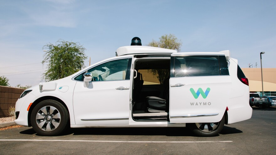 A self-driving Waymo Chrysler Pacifica in Chandler, Ariz., in July. The Department of Transportation says it wants to remove barriers to innovation in autonomous car technology.