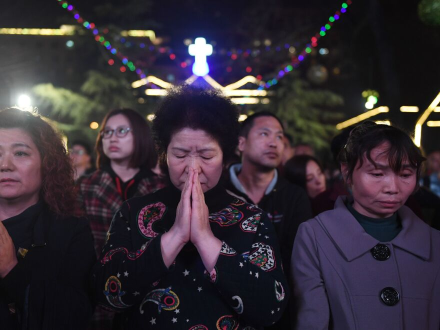 Catholics attend a mass on Holy Saturday as part of Easter celebrations in Beijing's government-sanctioned South Cathedral.