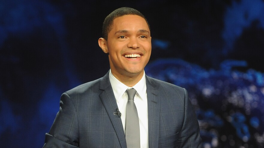 """Trevor Noah — who took over hosting from Jon Stewart in 2015 — remembers watching <em>The Daily Show </em>on CNN in South Africa. """"It looked like a news show and it had the same colors as CNN and the ticker,"""" he says. """"I just worked under the assumption that it was part of the news programming. ... I thought that Jon Stewart was a news anchor who didn't take his job seriously."""""""