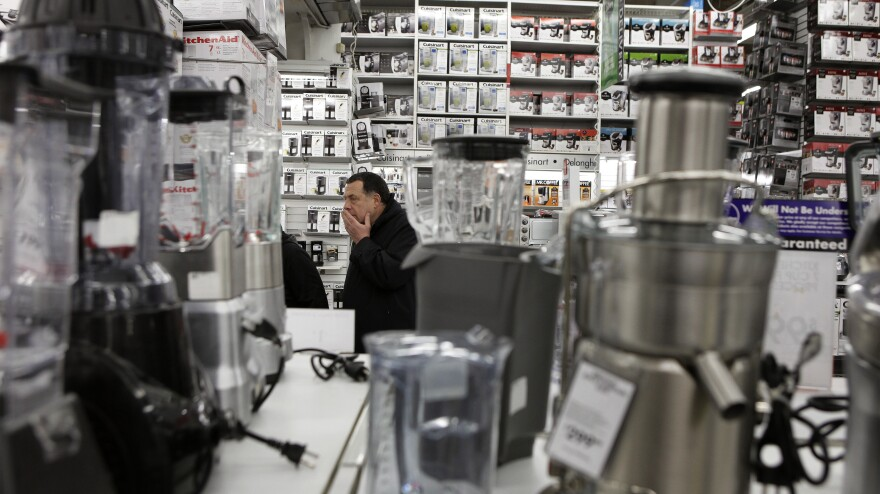 A man takes a closer look at kitchen appliances while shopping at a Bed Bath & Beyond store in New York.