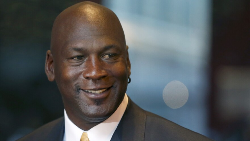 Michael Jordan says he is giving $1 million each to an NAACP legal fund and a community policing group to help find solutions to violence against African-Americans and police officers.
