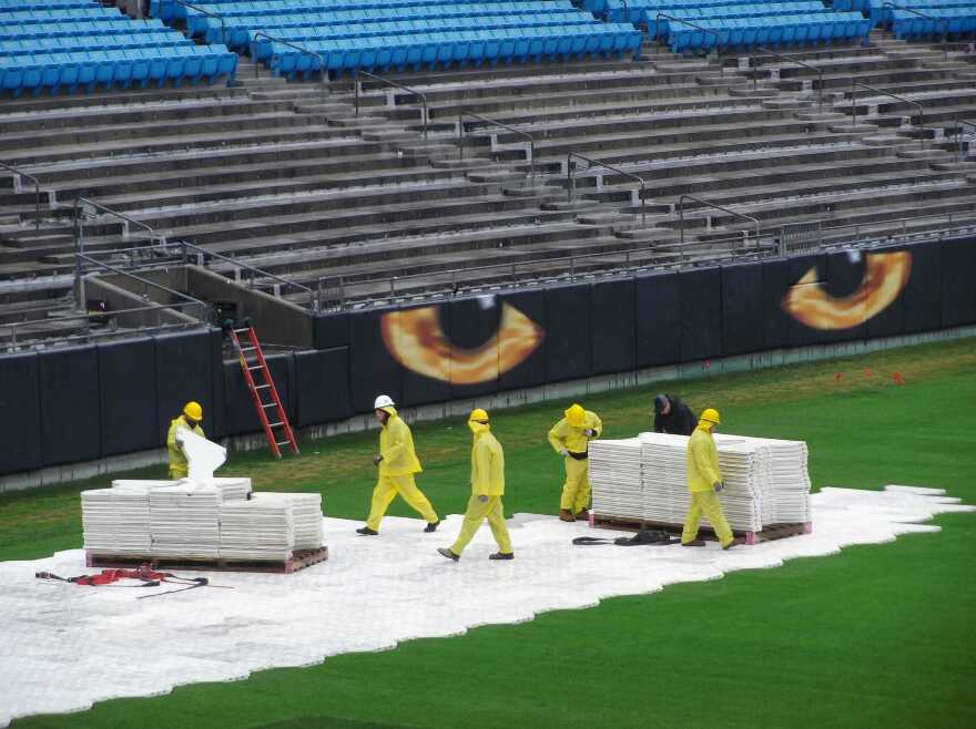 Workers have removed the first eight rows of seats in the west end zone at Bank of America Stadium to clear the way for new luxury boxes.