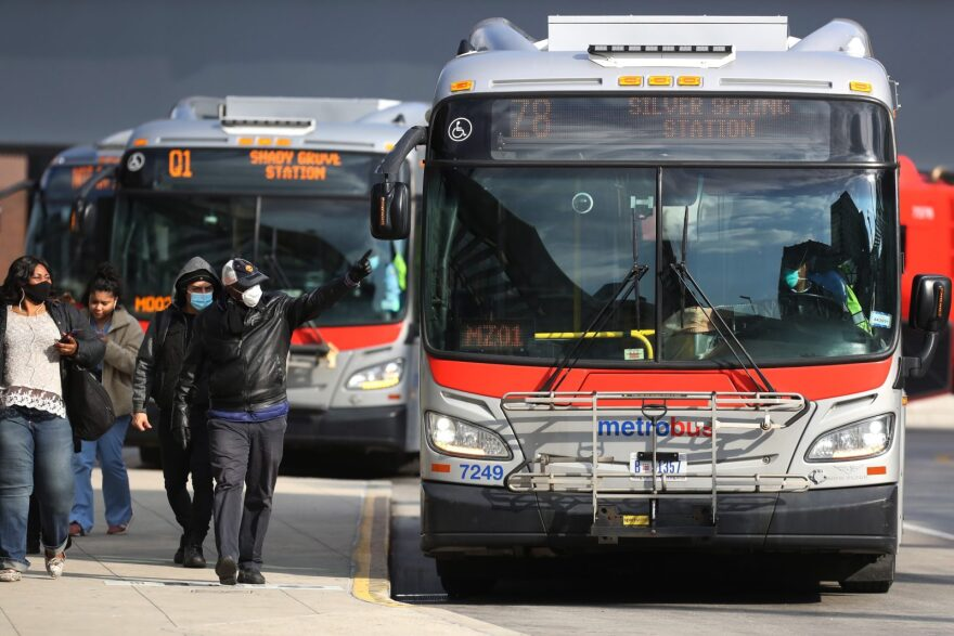 Commuters wear mandatory face coverings in an effort to prevent the spread of the novel coronavirus after stepping off a bus at the Sarbanes Transit Center in Silver Spring, Maryland.