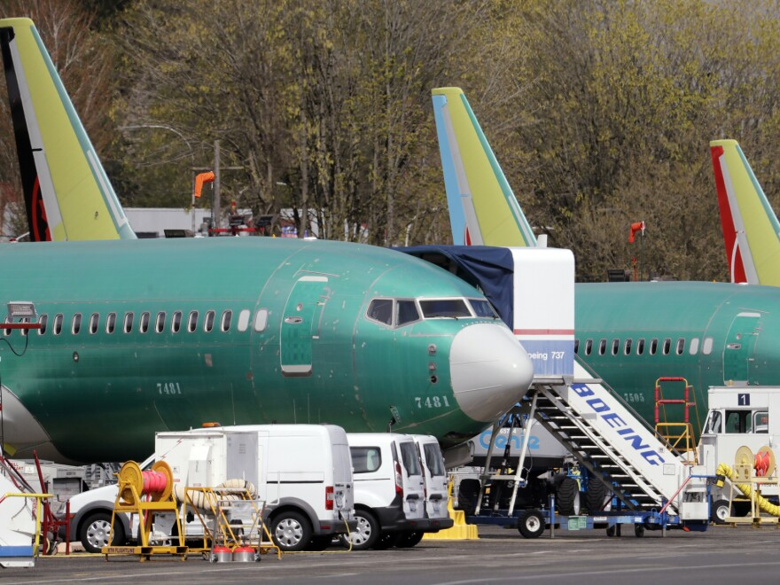 Boeing said on Sunday that it was aware of problems with a key safety indicator in 2017, but it didn't inform airlines or the FAA until after the Lion Air crash a year later. Here, 737 Max jets built for American Airlines (left) and Air Canada are parked at the airport adjacent to a Boeing production facility in Renton, Wash., in April.