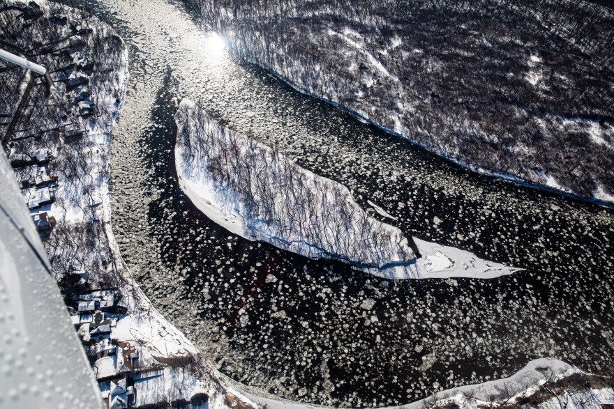 Ice flows around a small island in the Mississippi River near Dayton, Minn., on Feb. 13, 2020. Pilots take measurements to try and gauge how much water is in a snowpack.