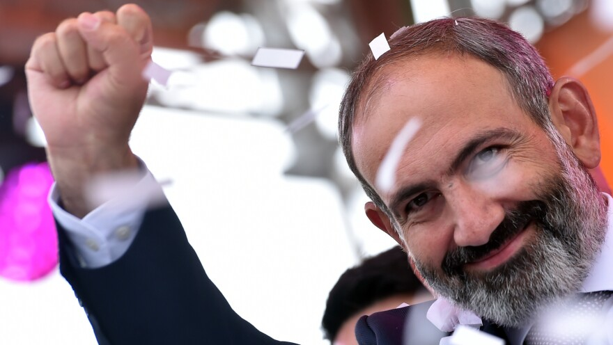 Nikol Pashinyan pumps his fist for supporters in Armenia's capital, Yerevan, not long after the prominent opposition leader was elected prime minister Tuesday.