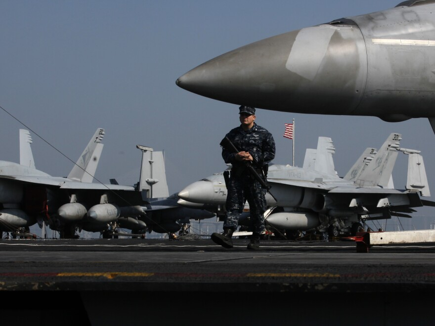 F/A-18 fighter jets on the flight deck of the aircraft carrier USS Carl Vinson in Hong Kong in 2011.