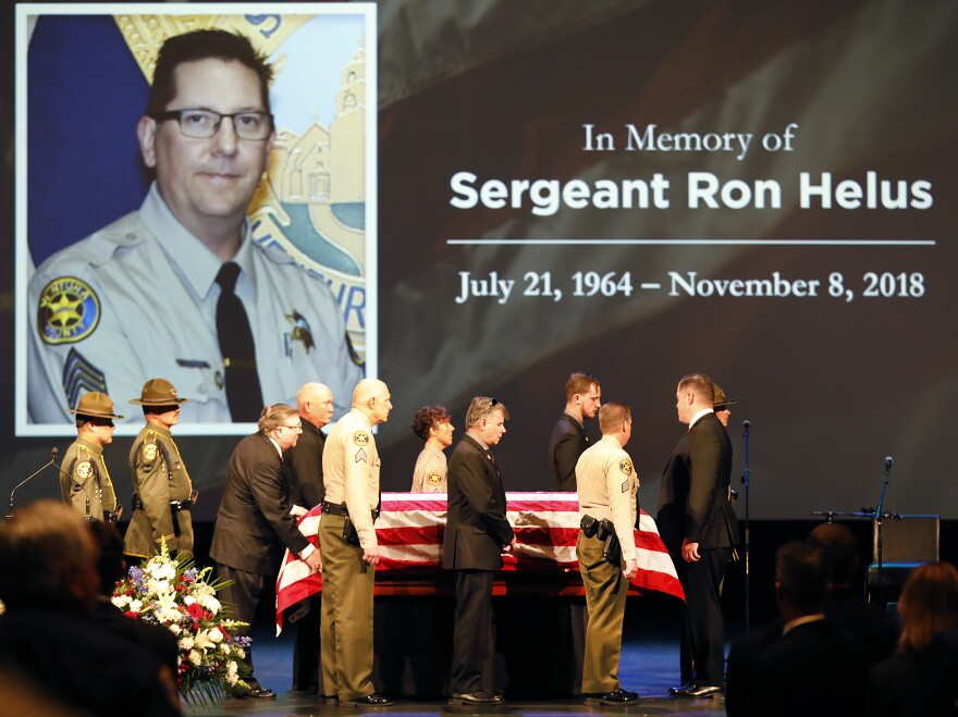The casket of Ventura County Sheriff Sgt. Ron Helus arrives on stage for a memorial service on Nov. 15 in Westlake Village, Calif.