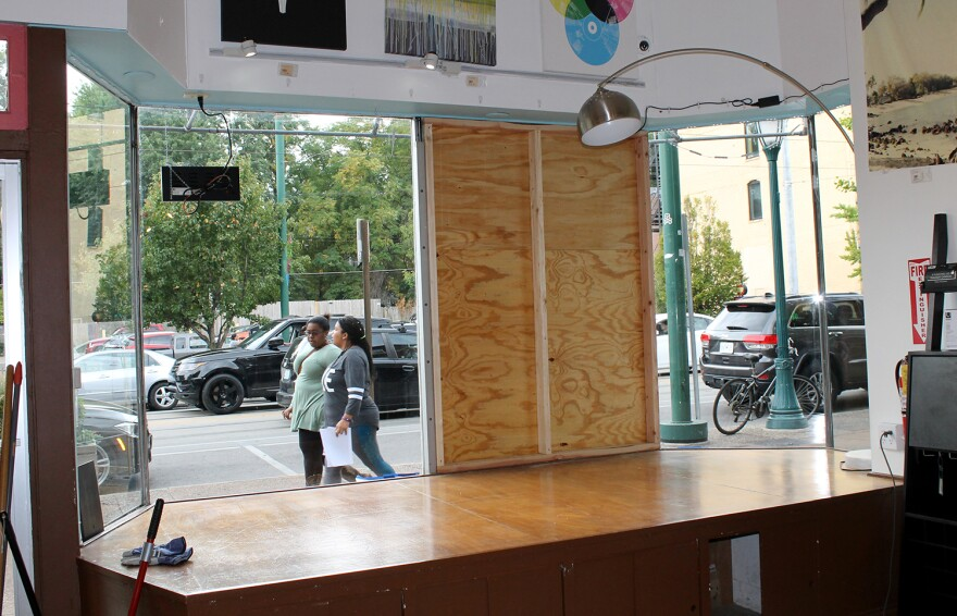 Plywood covers windows in Delmar Loop