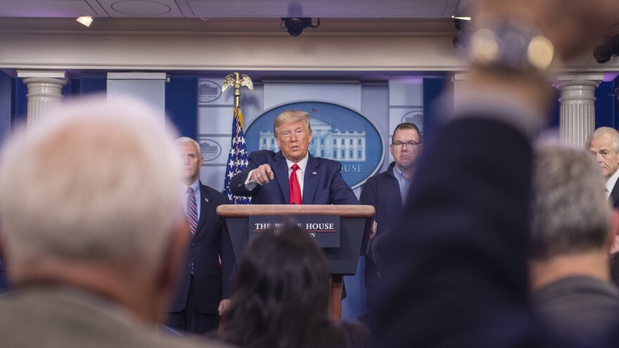 President Trump says he's not using his authority to control production and distribution of medical supplies.