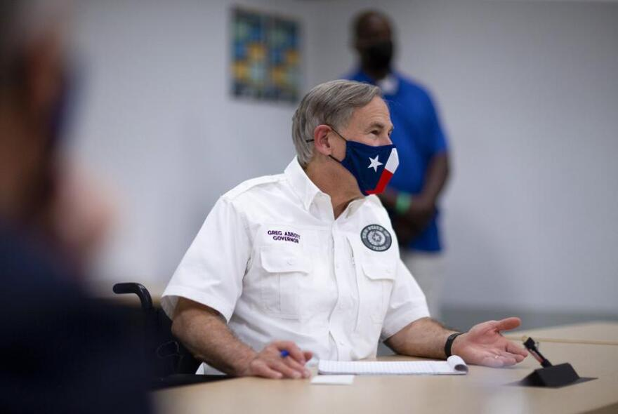 Gov. Greg Abbott meets with local leaders in El Paso to discuss the coronavirus situation in the city and state on Aug. 13, 2020.